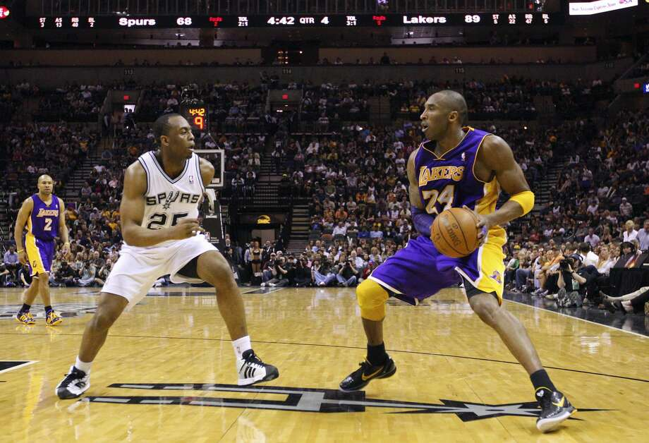 FOR SPORTS - Lakers' Kobe Bryant looks for room around Spurs' James Anderson during second half action Sunday March 6, 2011 at the AT&T Center. The Lakers won 99-83. (PHOTO BY EDWARD A. ORNELAS/eaornelas@express-news.net) (SAN ANTONIO EXPRESS-NEWS)