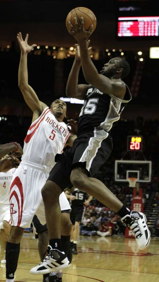 San Antonio Spurs shooting guard James Anderson (25) drives to the basket against Houston Rockets shooting guard Courtney Lee (5) during the first half of a pre-season NBA basketball game at Toyota Center Saturday, Dec. 17, 2011, in Houston. The Rockets beat the Spurs 101-87. ( Brett Coomer / Houston Chronicle ) (Chronicle)