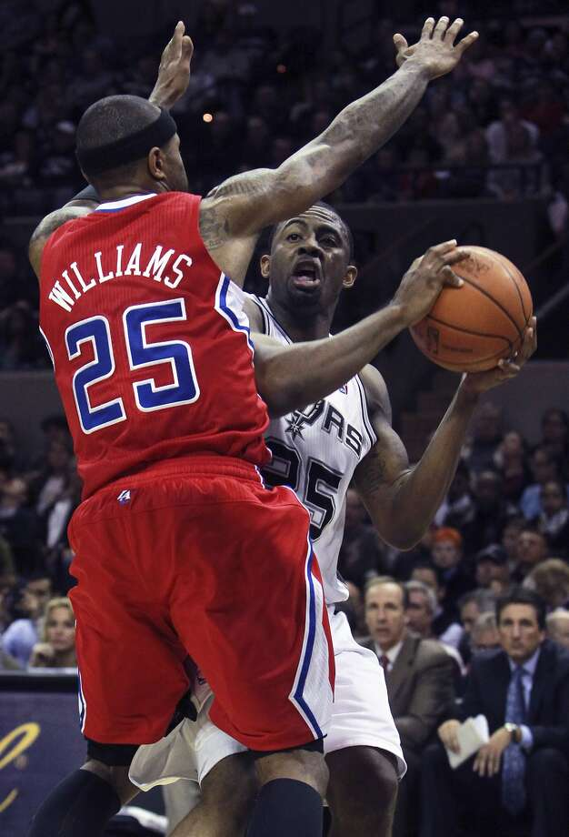 James Anderson pulls up for a shot against Mo Williams as San Antonio plays the Los Angeles Clippers at the AT&T Center on December 28, 2011 Tom Reel/Staff (SAN ANTONIO EXPRESS-NEWS)