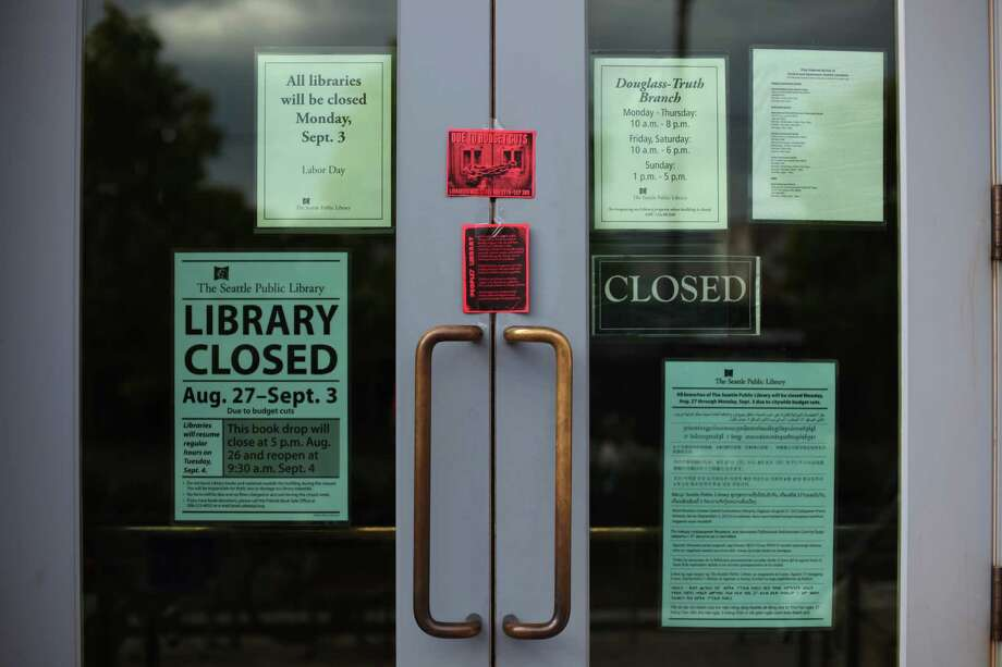 The doors of the Douglass-Truth Branch of the Seattle Public Library are shown during a week-long closure of the library, part of measures to trim from the city budget. 'The People's Library' was organized in response to the closure by community members and some members of the Occupy movement. The temporary library was a hit with neighborhood residents, drawing small crowds to browse the donated books, games and toys. Photo: JOSHUA TRUIJLLO / SEATTLEPI.COM