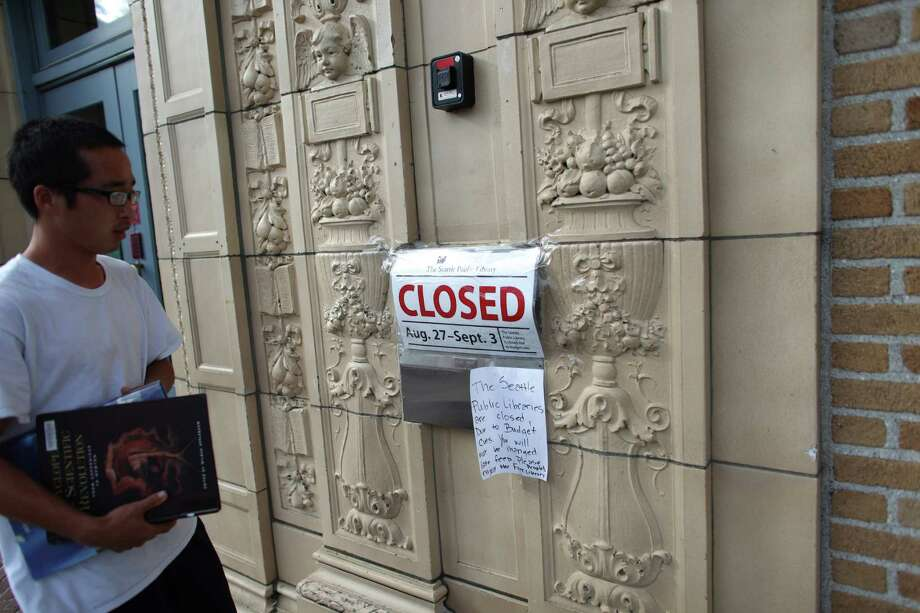 A patron finds the Douglass-Truth Branch of the Seattle Public Library closed during a week-long furlough, part of measures to trim from the city budget. Photo: JOSHUA TRUIJLLO / SEATTLEPI.COM