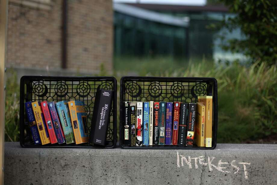 Books from 'The People's Library' are shown in front of the Douglass-Truth Branch of the Seattle Public Library during a week-long closure of the facility. Photo: JOSHUA TRUIJLLO / SEATTLEPI.COM