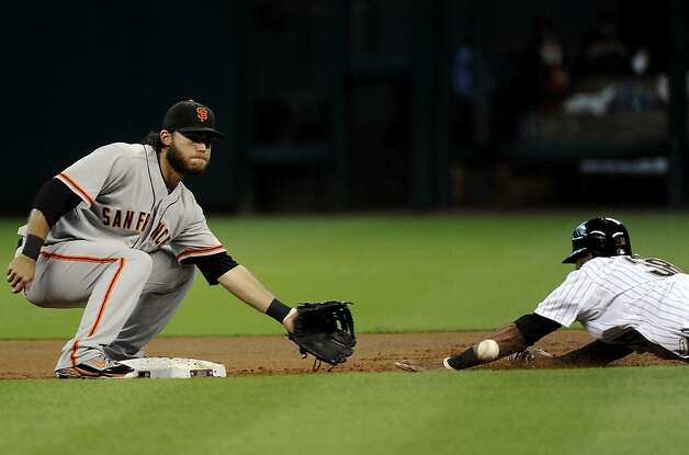 Houston Astros' Jimmy Paredes (38) steals second base as the ball bounces off his arm as San Francisco Giants' Brandon Crawford waits in the first inning of a baseball game Tuesday, Aug. 28, 2012, in Houston. (AP Photo/Pat Sullivan) Photo: Pat Sullivan, Associated Press