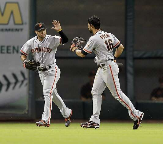 HOUSTON, TX - AUGUST 28: Angel Pagan #16 of the San Francisco Giants receives a high five from Gregor Blanco #7 of the San Francisco Giants after making a diving catch against the Houston Astros at Minute Maid Park on August 28, 2012 in Houston, Texas. (Photo by Bob Levey/Getty Images) Photo: Bob Levey, Getty Images