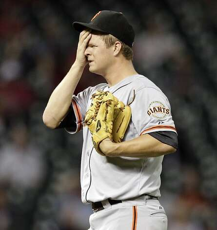 HOUSTON, TX. - AUGUST 28: Pitcher Matt Cain #18 of the San Francisco Giants wipes his face after giving up a home run to Fernando Martinez #21 of the Houston Astros in trhe fifth inning at Minute Maid Park on August 28, 2012 in Houston, Texas. (Photo by Bob Levey/Getty Images) Photo: Bob Levey, Getty Images