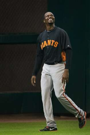 Giants relief pitcher Guillermo Mota smiles as he warms up in the outfield before the Giants faced the Houston Astros at Minute Maid Park on Tuesday, Aug. 28, 2012, in Houston.  Mota was activated Tuesday following the end of his 100-game suspension. ( Smiley N. Pool / Houston Chronicle ) Photo: Smiley N. Pool, Houston Chronicle
