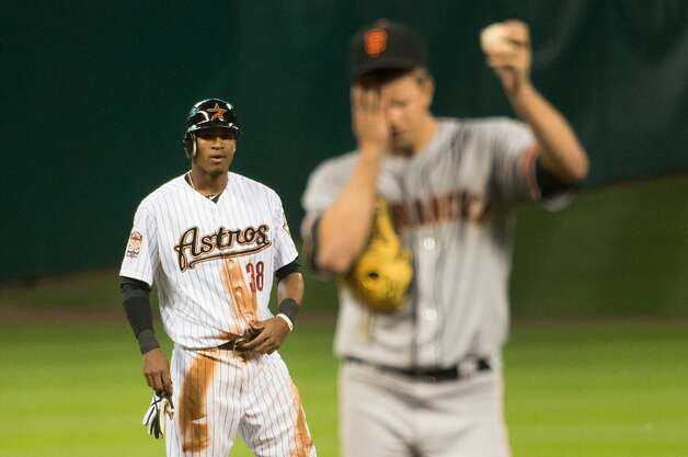 Astros right fielder Jimmy Paredes looks on as Giants starting pitcher Matt Cain wipes his face after stealing second base during the first inning against the Giants at Minute Maid Park on Tuesday, Aug. 28, 2012, in Houston. Paredes, who started at third base for the Astros for two months in 2011, was called up from Class AAA Oklahoma City where he has transitioned to the outfield. ( Smiley N. Pool / Houston Chronicle ) Photo: Smiley N. Pool, Houston Chronicle
