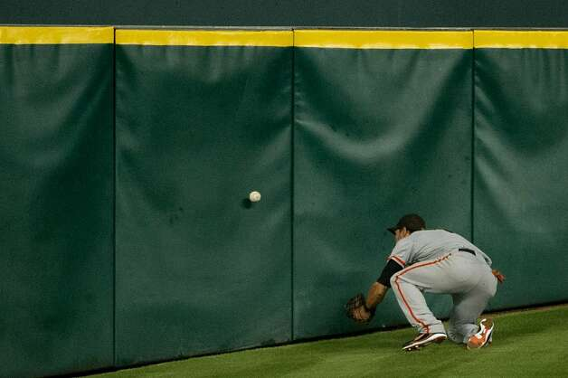 Giants center fielder Angel Pagan tries to play a ball off the wall on a double by Astros first baseman Brett Wallace fourth inning at Minute Maid Park on Tuesday, Aug. 28, 2012, in Houston. ( Smiley N. Pool / Houston Chronicle ) Photo: Smiley N. Pool, Houston Chronicle