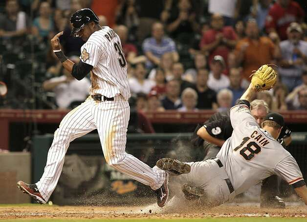 HOUSTON, TX. - AUGUST 28: Jimmy Paredes #38 of the Houston Astros scores in the eighth inning on a wild pitch by pitcher Matt Cain #18 of the San Francisco Giants at Minute Maid Park on August 28, 2012 in Houston, Texas. (Photo by Bob Levey/Getty Images) Photo: Bob Levey, Getty Images