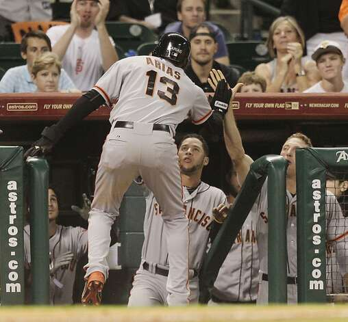 HOUSTON, TX. - AUGUST 28: Joaquin Arias #13 of the San Francisco Giants receives a high five from Hunter Pence #8 of the San Francisco Giants after scoring in the ninth inning against the Houston Astros at Minute Maid Park on August 28, 2012 in Houston, Texas. (Photo by Bob Levey/Getty Images) Photo: Bob Levey, Getty Images