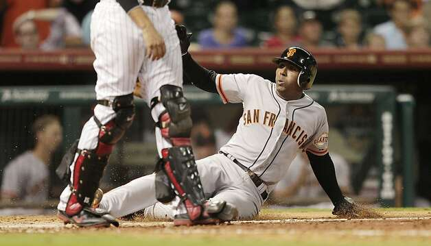 HOUSTON, TX. - AUGUST 28: Joaquin Arias #13 of the San Francisco Giants scores in the ninth inning on asingle by Hector Sanchez #29 of the San Francisco Giants against the Houston Astros at Minute Maid Park on August 28, 2012 in Houston, Texas. (Photo by Bob Levey/Getty Images) Photo: Bob Levey, Getty Images