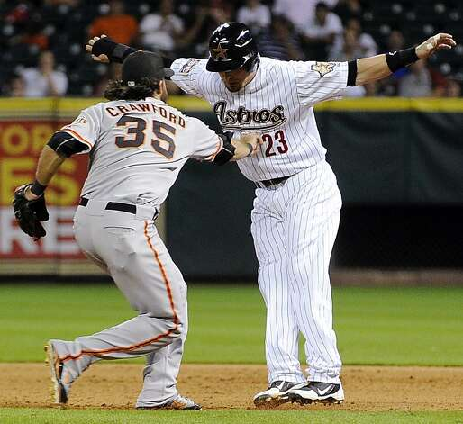 Houston Astros' Tyler Greene (23) is tagged out by San Francisco Giants' Brandon Crawford (35) trying to steal second base in the eighth inning of a baseball game, Tuesday, Aug. 28, 2012, in Houston. (AP Photo/Pat Sullivan) Photo: Pat Sullivan, Associated Press