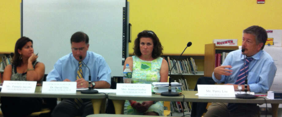 Board member Perry Liu, far right, speaks during the Board of Education's discussion Tuesday night on the presence of PCBs at Osborn Hill Elementary School. Seated to his left, from left to right, are Board Chairwoman Pamela Iacono, Schools Superintendent David Title and board member Jessica Gerber. Photo: Michael C. Juliano/Staff Photo
