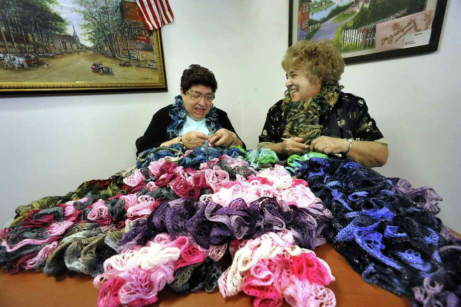 Kay Perna, 76, left, and Hilda Nichols, 83, knit scarfs for a fundraiser to buy a new coffee pot for the Senior Center. A commercial coffee maker costs about $1,900. On a busy day the center serves 200 cups of coffee. Photographed Tuesday, Aug. 28, 2012. Photo: Michael Duffy