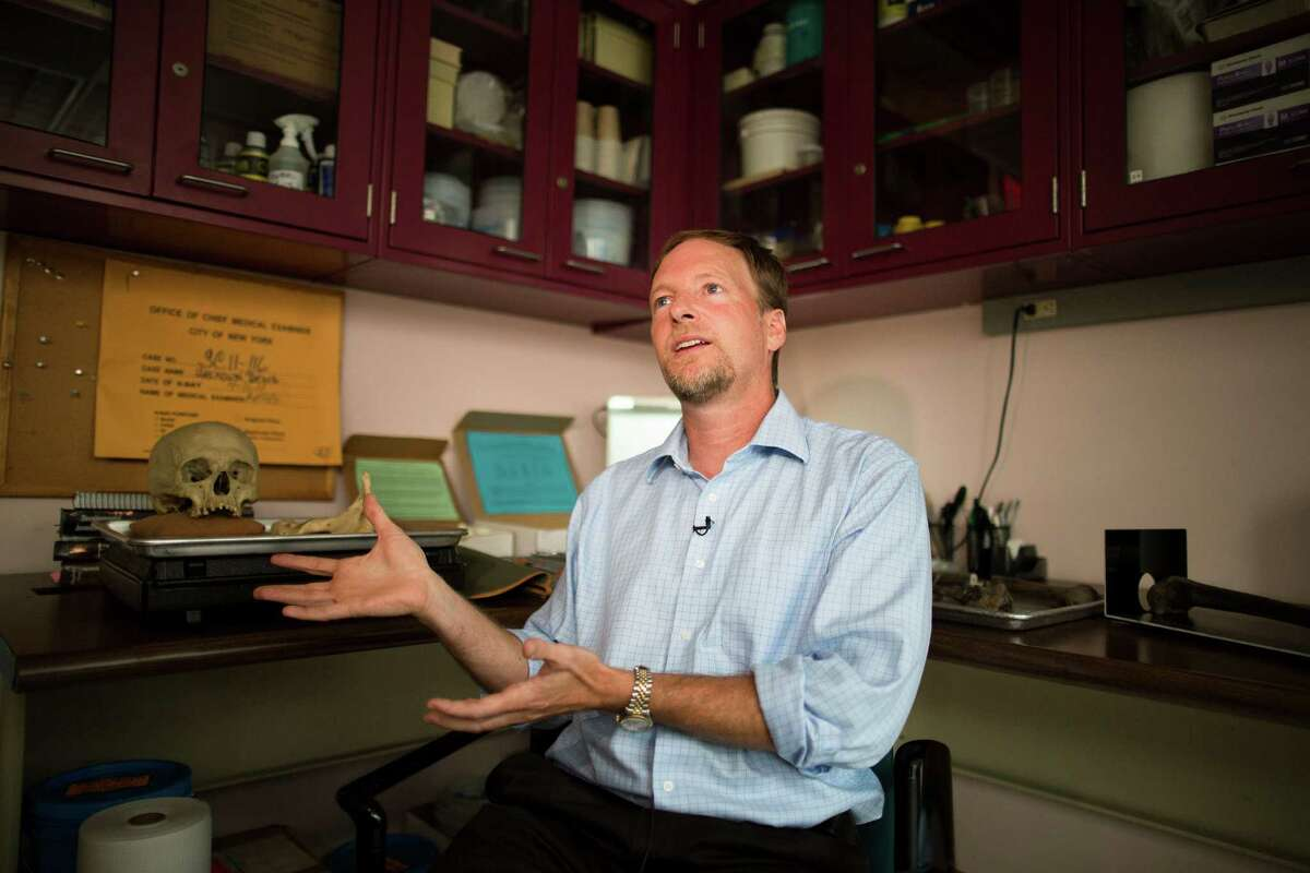 Bradley Adams, Ph.D., Director of Forensic Anthropology at the City of New York Office of Chief Medical Examiner speaks during an interview beside anatomical specimens, Tuesday, Aug. 14, 2012, in New York. The office is undertaking an ambitious effort to identify the nameless dead in the cityÃ'Â's potterÃ'Â's field, seeking to capitalize on the expertise that it gained over the last decade identifying remains from the World Trade Center attack.