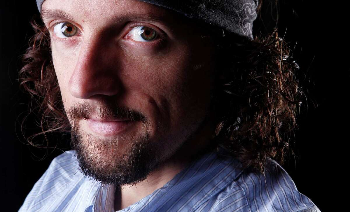"""In this March 8, 2012 photo, musician Jason Mraz poses for a portrait in New York. The singer-songwriter, known for feel-good and hippie hits like ?""""I'm Yours?"""" and ?""""The Remedy (I Won't Worry),?"""" released his latest album ?""""Love Is a Four Letter Word,?"""" on Tuesday. (AP Photo/Carlo Allegri)"""