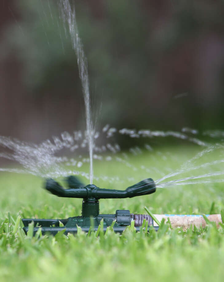 To avoid excessive evaporation, use a sprinkler that produces large drops of water, rather than a fine mist. Photo: HELEN L. MONTOYA, SAN ANTONIO EXPRESS-NEWS / hmontoya@express-news.net
