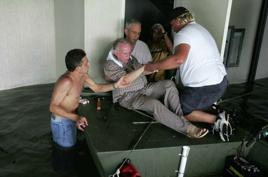 A Hurricane Katrina victim is rescued from and office building where he and 75 other hurricane victims spent two days after floodwaters from the storm invaded their homes Tuesday, Aug. 30, 2005, in New Orleans, La. Photo: BRETT COOMER, HOUSTON CHRONICLE / HOUSTON CHRONICLE