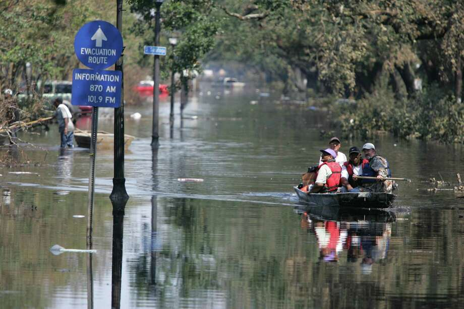 Hurricane Katrina victims are taken by boat out of their neighborhood where they have been trapped by floodwaters Sunday, Sept. 4, 2005, in New Orleans, La. Photo: BRETT COOMER, HOUSTON CHRONICLE / HOUSTON CHRONICLE