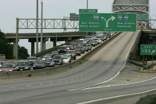 Westbound traffic is backed up over the Mississippi River Bridge as the evacuation from Hurricane Katrina continues Sunday, Aug. 28, 2005, in Baton Rouge, La. Photo: BRETT COOMER, HOUSTON CHRONICLE / HOUSTON CHRONICLE