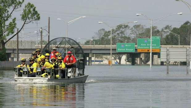 Search and Rescue personnel are loaded on an air boat as they go out to find people stranded by floodwaters from Hurricane Katrina Tuesday, Aug. 30, 2005, in New Orleans, La. Photo: BRETT COOMER, HOUSTON CHRONICLE / HOUSTON CHRONICLE