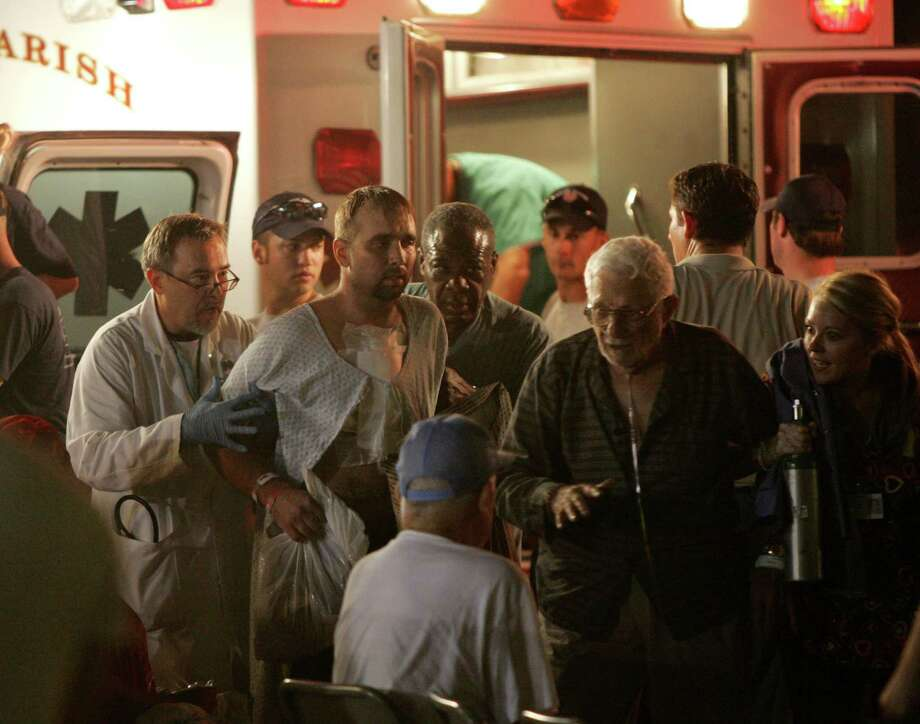 Sick and injured victims of Hurricane Katrina are unloaded from ambulances to be cared for at a makeshift hospital on the campus of Louisiana State University Wednesday, Aug. 31, 2005, in Baton Rouge, La. Photo: BRETT COOMER, HOUSTON CHRONICLE / HOUSTON CHRONICLE