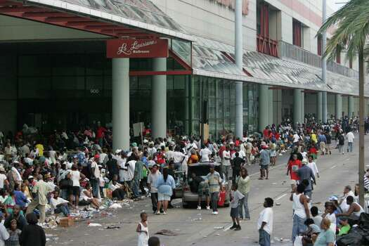Thousands of Hurricane Katrina refugees wait outside the convention center to be evacuated on buses that never came Thursday, Sept. 1, 2005, in New Orleans. La. Photo: BRETT COOMER, HOUSTON CHRONICLE / HOUSTON CHRONICLE