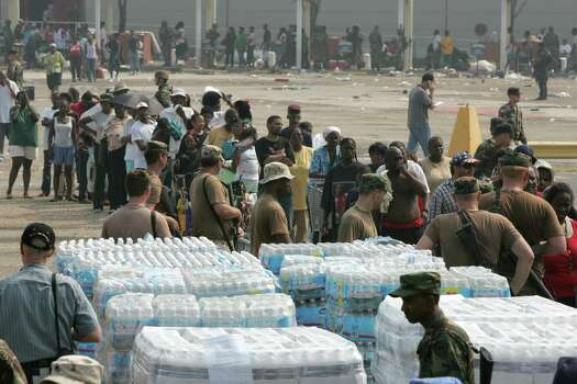 Hurricane Katrina victims line up to receive food and water from National Guard units outside the convention center Friday, Sept. 2, 2005, in New Orleans. La. Photo: BRETT COOMER, HOUSTON CHRONICLE / HOUSTON CHRONICLE