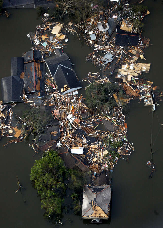 Homes destroyed by floodwaters from Hurricane Katrina are shown in this aerial view Tuesday, Aug. 30, 2005 in New Orleans. Hurricane Katrina did extensive damage when it made landfall on Monday. Photo: DAVID J. PHILLIP, AP / AP