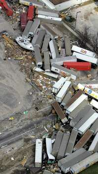 A boat sits among trailers damaged by Hurricane Katrina Wednesday, Aug. 31, 2005, in Gulfport, Miss. Photo: DAVID J. PHILLIP, AP / AP
