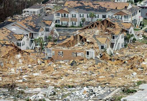 An apartment complex damaged by Hurricane Katrina is shown in this aerial view Wednesday, Aug. 31, 2005 in Long Beach, Miss. Photo: DAVID J. PHILLIP, AP / AP