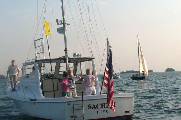 The Wednesday Night Twilight Series featured races between Indian Harbor Yacht Club and Old Greenwich Yacht Club off Greenwich Harbor on August 22, 2012. Photo: Picasa, Anne W. Semmes