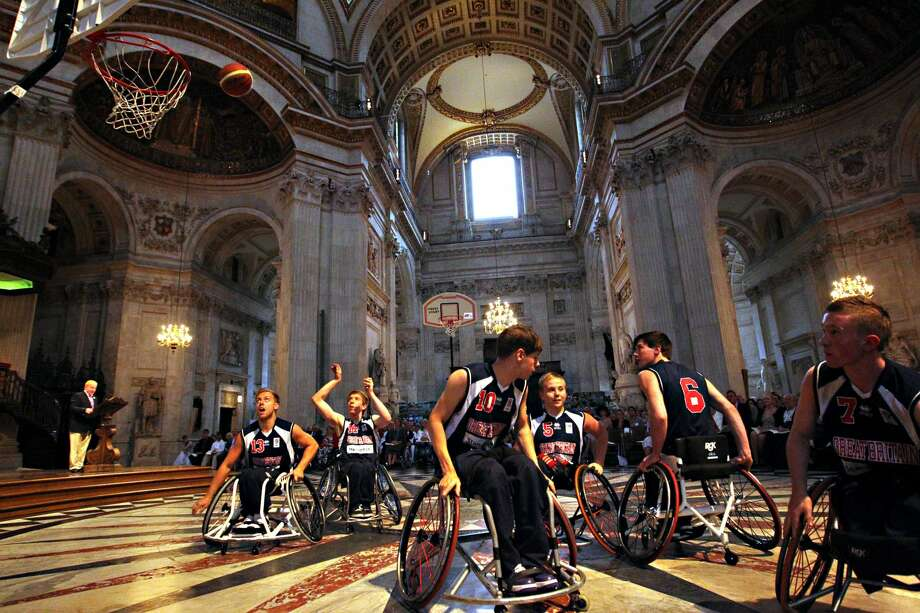 A wheelchair basketball demonstration by the GB Men's Under-22 team takes place at St Paul's Cathedral in London, where a service of 'Courage and Faith' was held to mark the opening of the 2012 London Paralympic Games.  (Sean Dempsey / Associated Press)