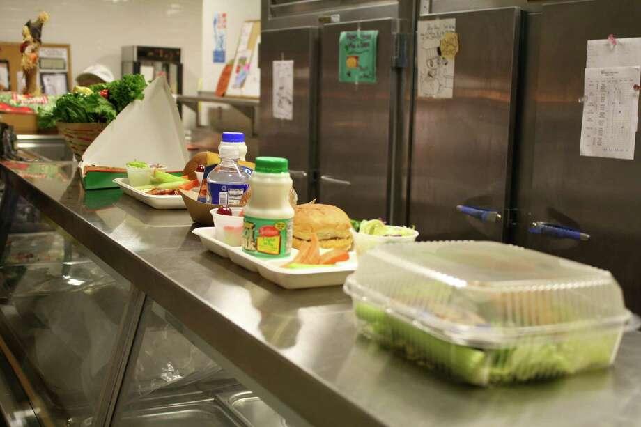 School lunches for the day are displayed in the Toekeneke School cafeteria.Tokeneke School, Darien, Conn. Aug. 29, 2012 Photo: Megan Davis