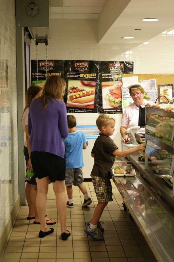 Several students buying lunch at Tokeneke School. Tokeneke School, Darien, Conn. Photo: Megan Davis