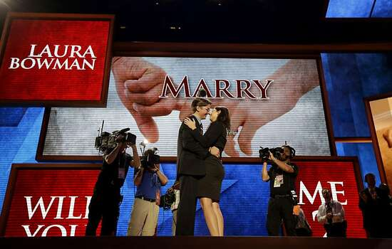 Bradley Thompson, production manager for the Republican National Convention, left, proposes to his girlfriend Laura Bowman, a production coordinator, on the stage of the convention hall, Wednesday, Aug. 29, 2012, in Tampa, Fla. (AP Photo/David Goldman) Photo: David Goldman, Associated Press