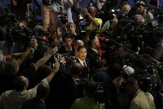 Sen. Marco Rubio, R-Fla. speaks to reporters on the foor of the Republican National Convention in Tampa, Fla., on Wednesday, Aug. 29, 2012. Photo: Charles Dharapak, Associated Press