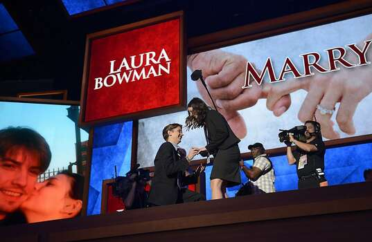 Bradley Thompson, a production manager, proposes to production coordinator Laura Bowman onstage before the third day of the 2012 Republican national Convention at the Tampa Bay Times Forum August 29, 2012 in Tampa, Florida. Photo: Brendan Smialowski, AFP/Getty Images