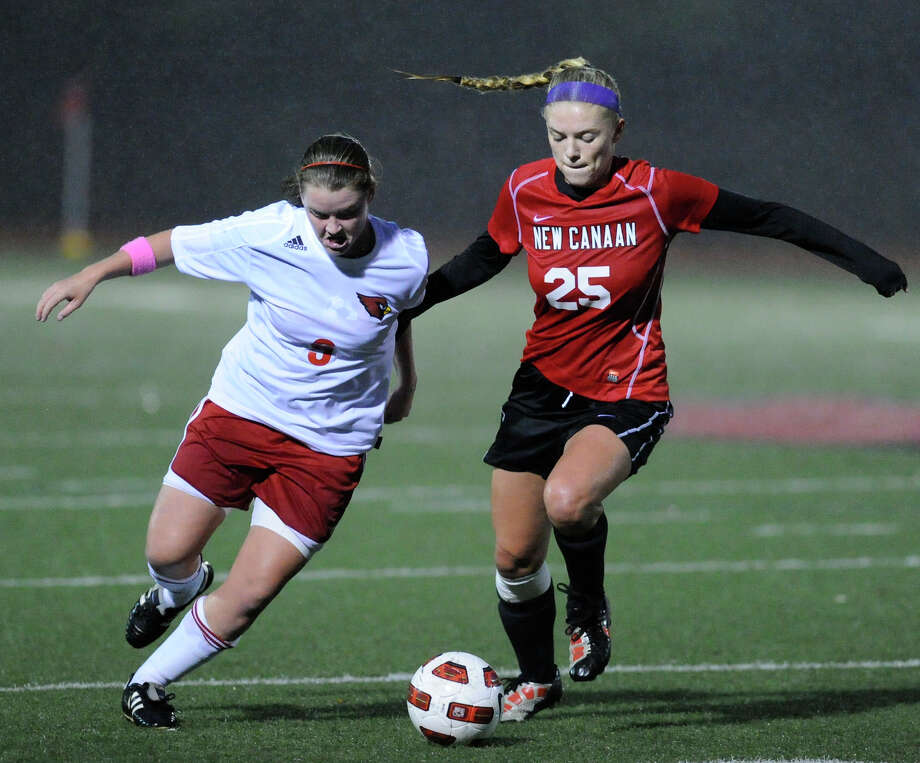 Shannon Colligan, # 9 of Greenwich High School, at left, goes for the ball against Kelly Armstrong, # 25 of New Canaan High School during girls high school soccer match between Greenwich High School and New Canaan High School at Greenwich, Thursday night, Oct. 27, 2011. Photo: Bob Luckey / Greenwich Time