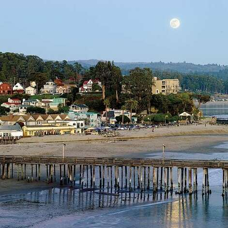 "Capitola, CA: Capitola-by-the-Sea started in the 1860s as a resort town, a place for people from ""over the hill"" in San Jose to escape the heat. In the 1920s, it took on a Mediterranean feel, sprouting bungalows and stucco shacks reminiscent of those found in Italian fishing villages. But the Mediterranean doesn't have surf like Capitola's. That's why world-renowned surfboard and wetsuit manufacturer O'Neill is headquartered here, and why marine environmental causes are big. And why even residents like Stephen Hanecak, chef at the Paradise Beach Grille, learn to balance their time between hard work and play. ""Four or five days a week,"" he says, ""I'm out there first thing with my surfboard, trying to start my day by catching some waves."" Read more: Top 10 national park beaches Photo: Thomas J. Story, Sunset.com"