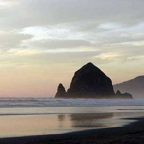 Cannon Beach, OR: It's got dramatic coastal skies, a natural icon in the form of the striking Haystack Rock (pictured), and rows of galleries to help you while away the time when you need a break from the sun and sand. But Cannon Beach is also foodie central, ideal for getting your seafood and beer fix or indulging in a roster of ambitious restaurants. Some of our faves include Fishes ($$$; fishes-sushi.com), a Tokyo-worthy sushi restaurant; Evoo ($$$$; evoo.biz), a cooking school with a nightly dinner cooking show; and Bill's Tavern and Brewhouse ($$; billstavernandbrewhouse.com) with prizewinning Duckdive Pale Ale. Read more: Top 10 lake vacations Photo: Cheryl Koschalk Comsia, Sunset.com