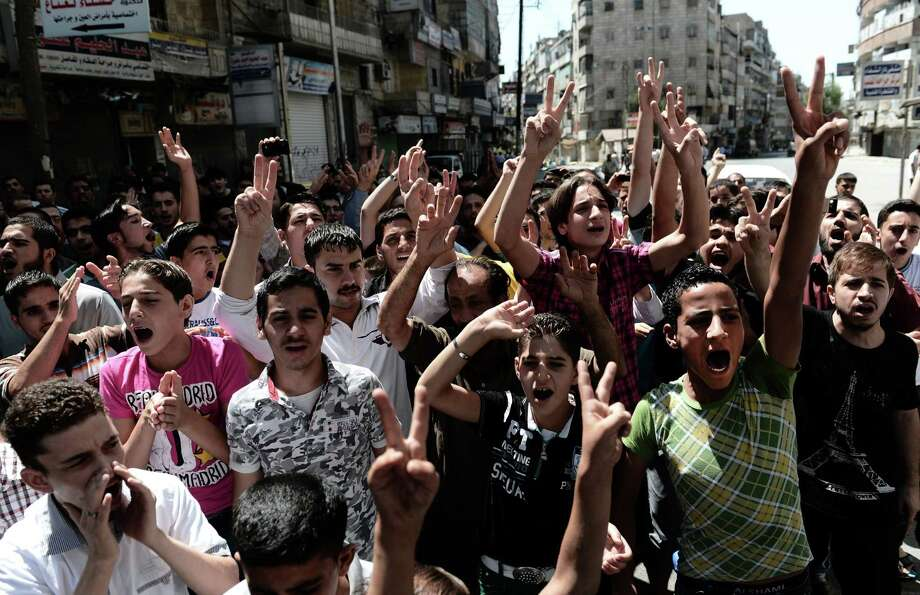Syrian youths shout anti-government slogans during a demonstration in Syria's northern city of Aleppo, on August 24, 2012. Syrian forces blitzed areas in and around the Aleppo, activists said, as Western powers sought to tighten the screws on embattled President Bashar al-Assad. Photo: ARIS MESSINIS, AFP/Getty Images / AFP