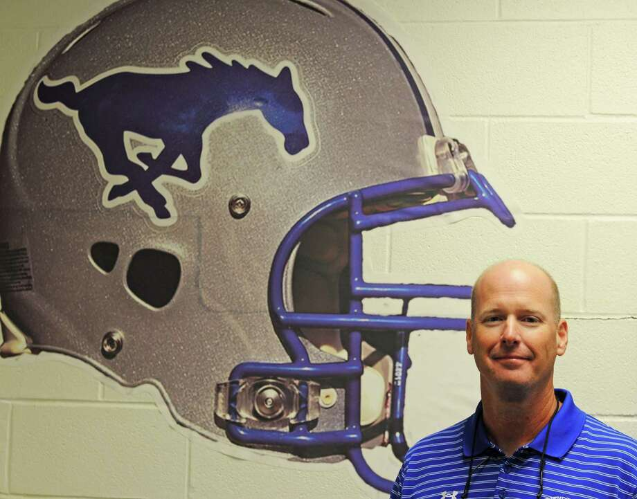 Friendswood football new head coach Robert Koopmann is no stranger to the Mustangs having served as an assistant coach at the school for 18 years prior to taking over for the 2012 campaign. Photo: L. Scott Hainline / The Chronicle