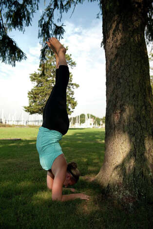 Owner of Venture Yoga in Darien, Conn., Erin Huot, performs a forearm stand. Photo: Contributed