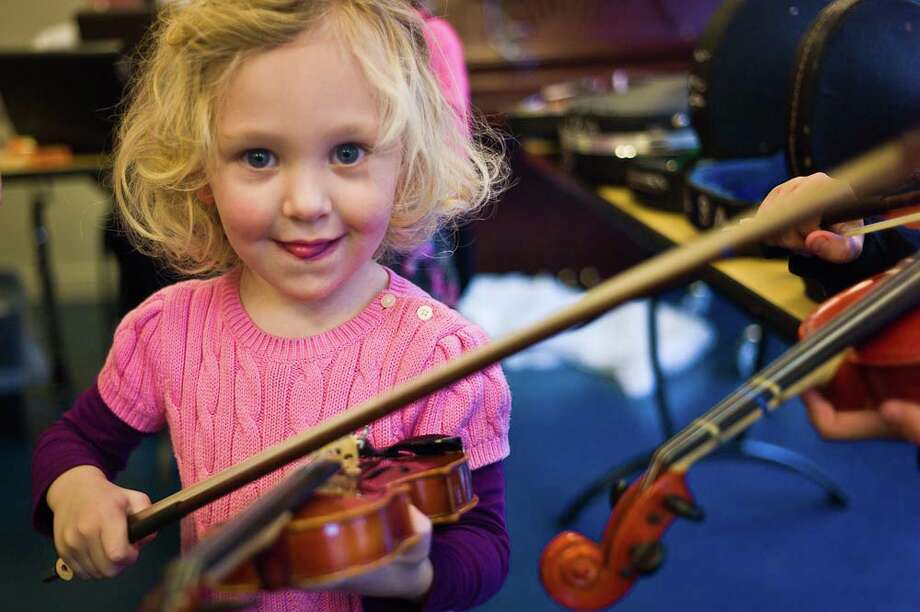 "The Neighborhood Music School, in New Haven, will host an ""open house"" and instrument petting zoo on Saturday, Sept. 8. The school, which is open to children and adults, is billed as one of the 10 largest arts schools in the country. Photo: Contributed Photo / Connecticut Post Contributed"