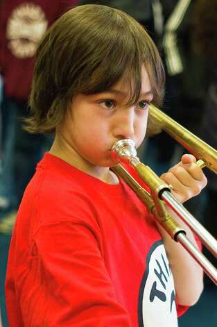 "The Neighborhood Music School will host an ""open house"" and instrument petting zoo on Saturday, Sept. 8, at which kids can try out various instruments. Photo: Contributed Photo / Connecticut Post Contributed"