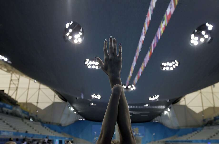 A swimmer warms up in the Aquatic Center during a swimming training session ahead of the 2012 Paralympics, Wednesday, Aug. 29, 2012, in London. (AP Photo/Lefteris Pitarakis) Photo: Lefteris Pitarakis, Associated Press