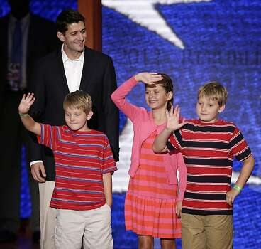 Republican vice presidential nominee, Rep. Paul Ryan of Wisconsin walks across the stage with sons Sam, left, Charlie, right, and daughter Liza during a podium sound check at the Republican National Convention in Tampa, Fla., on Wednesday, Aug. 29, 2012. Photo: J. Scott Applewhite, Associated Press