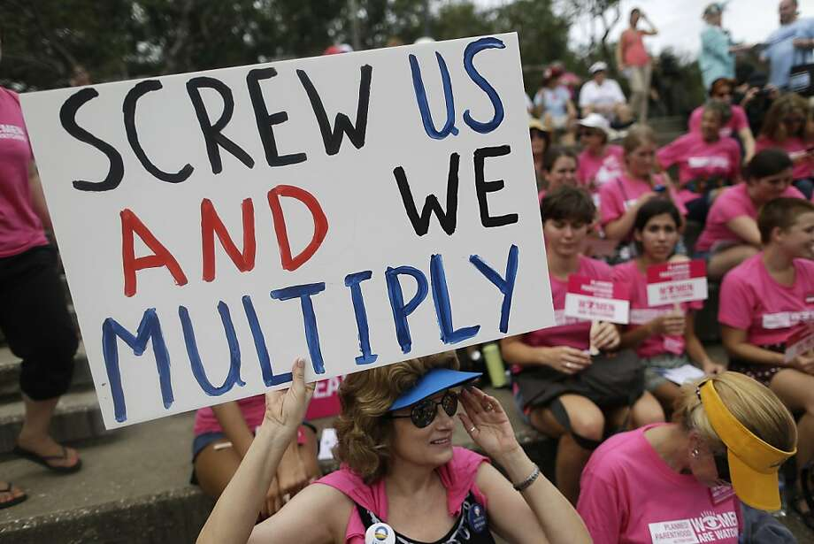 Demonstrators participate in a protest rally, Wednesday, Aug. 29, 2012, in Tampa, Fla. Protestors gathered in Tampa to march in demonstration against the Republican National Convention. Photo: Patrick Semansky, Associated Press