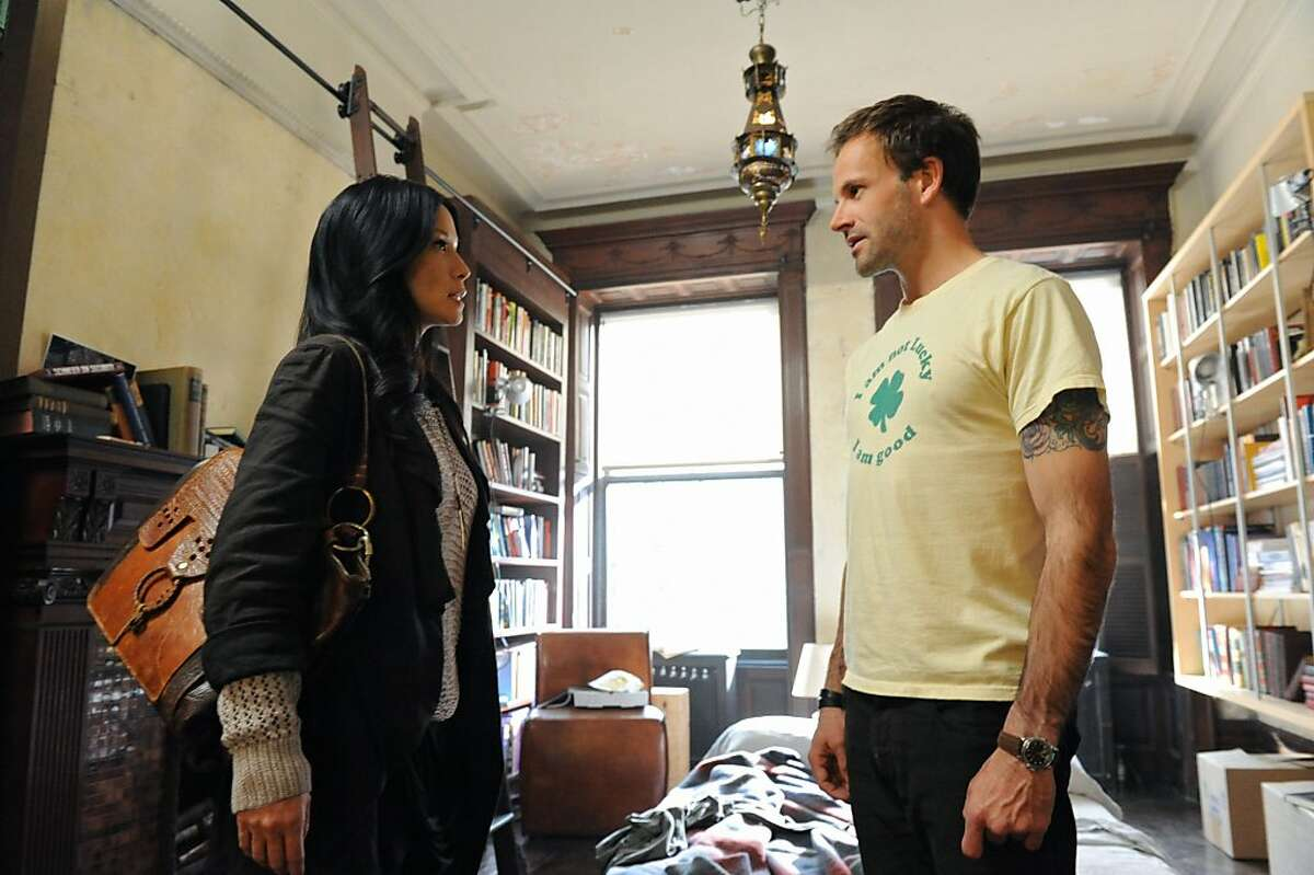 Pilot-- Jonny Lee Miller (right) stars as Sherlock Holmes and Lucy Liu (left) stars as Watson on the new television series ELEMENTARY, premiering Thursdays, 10pm ET/PT this Fall on the CBS Television Network.